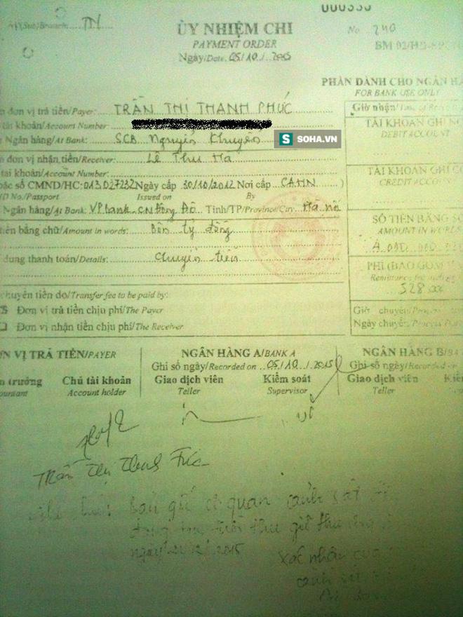 Giấy uỷ nhiệm chi được mang tới ngân hàng, bà Phúc xác nhận đúng là chữ ký của bà