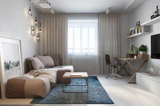 Góc làm việc xinh xắn được bố trí hợp lý ngay góc nhà tràn ngập ánh sáng. Việc kết hợp hài hòa về màu sắc giữa nội thất và sơn tường trong căn hộ này càng khiến không gian trở nên thoáng rộng không ngờ.