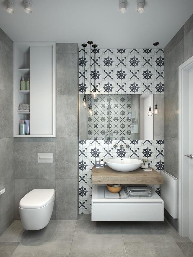 Không gian trong nhà vệ sinh cũng được tận dụng tối đa diện tích bởi tủ âm tường.