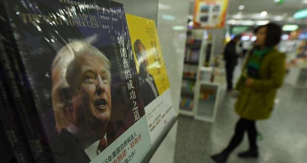 Trung Quốc dọa giảm mua iPhone, xe hơi Mỹ nếu Trump phát động chiến tranh thương mại