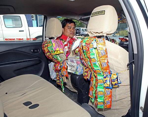 Vinasun bán bưởi không có gì mới, nhiều năm nay ở Philippines đã có lái xe taxi thu vài trăm nghìn mỗi ngày nhờ bán bim bim