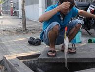 Cạy cống câu cá, thú vui vỉa hè của dân Sài Gòn