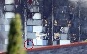 Hình ảnh người còn sống mắc kẹt bên trong tòa nhà 27 tầng bị lửa bao trùm, nhiều người được xác nhận đã chết