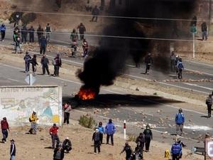 Thứ trưởng Bolivia bị thợ mỏ biểu tình đánh chết