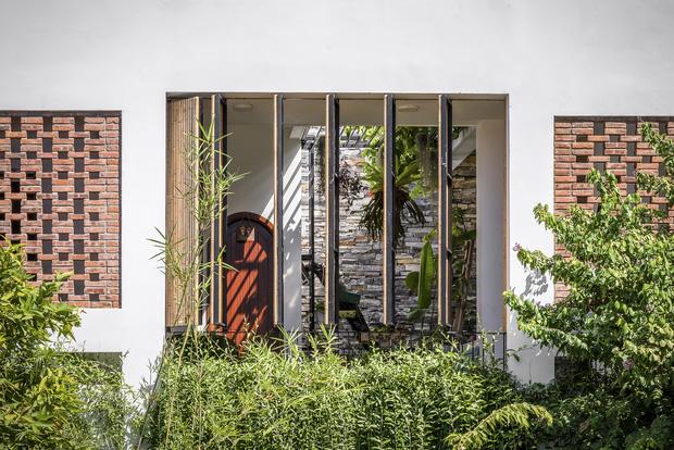Ngôi nhà 125m2 đẹp như resort của cặp đôi yêu nhau từ cấp ba, đầu tư 2 tỷ với thiết kế đưa gió vào mọi ngóc ngách - Ảnh 2.