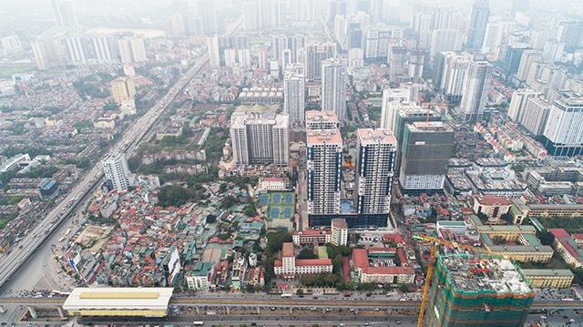 Doanh nghiệp địa ốc phía Nam ồ ạt đổ về Hà Nội, thách thức là gì?  - Ảnh 1.