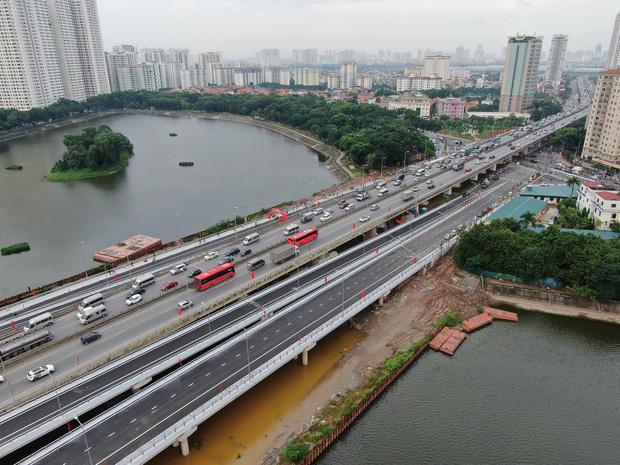 Chùm ảnh: Khánh thành cầu vượt thấp qua hồ Linh Đàm - Ảnh 15.