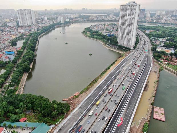 Chùm ảnh: Khánh thành cầu vượt thấp qua hồ Linh Đàm - Ảnh 9.