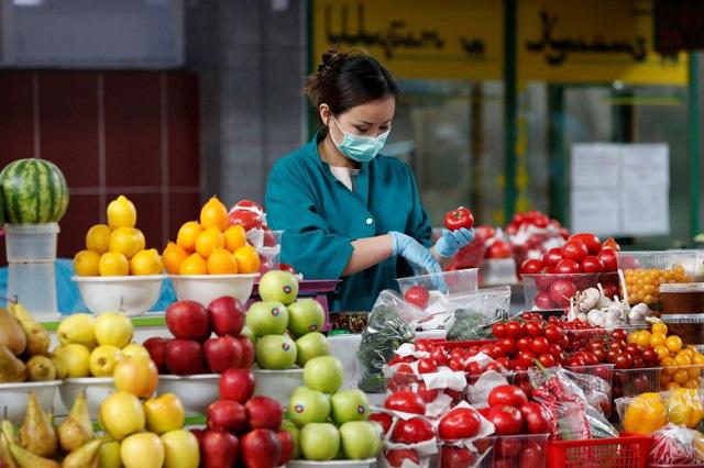 Làn sóng tích trữ lương thực lan rộng trên thế giới vì dịch Covid-19  - Ảnh 1.