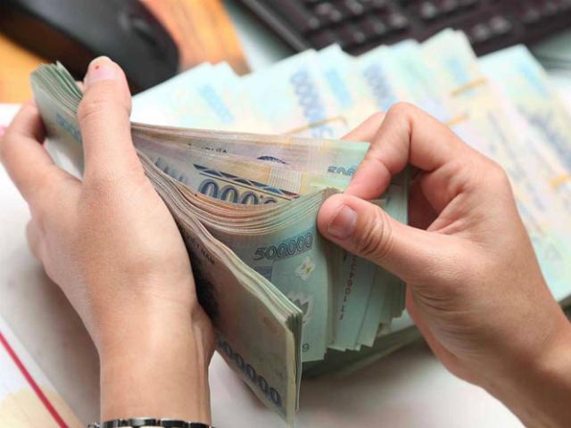 Phó Thống đốc: Lợi nhuận của Vietcombank, VietinBank, BIDV, Agribank phải giảm ít nhất 40% cho việc hạ lãi suất - Ảnh 1.