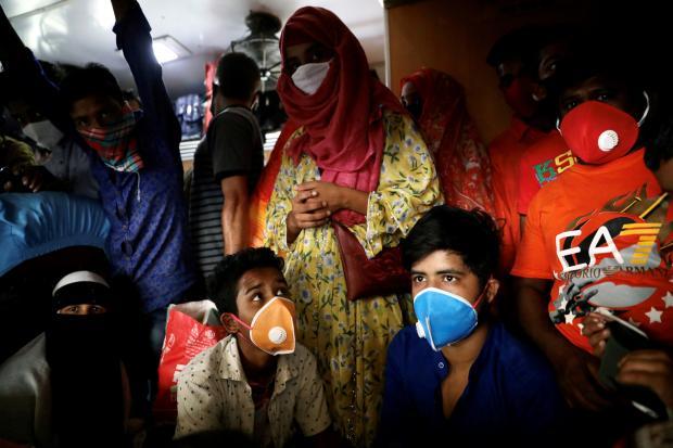 Ấn Độ áp dụng chiến thuật kiểm soát dịch bệnh cứng rắn bậc nhất thế giới như thế nào? - Ảnh 4.