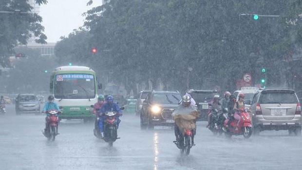 Đón không khí lạnh giữa mùa hè, Hà Nội và các tỉnh Bắc Bộ mưa dông diện rộng - Ảnh 1.