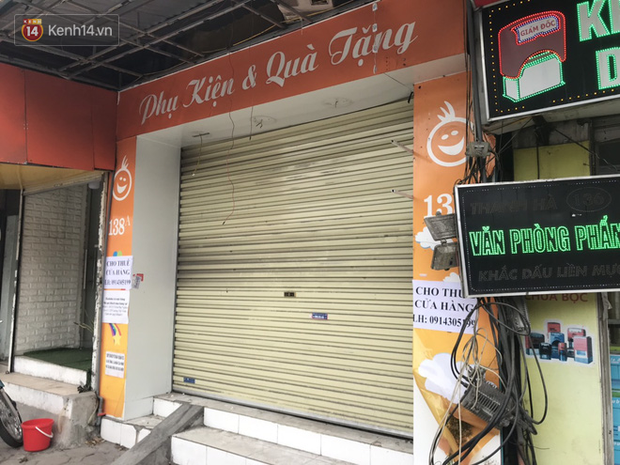 Phố kinh doanh sầm uất tại Hà Nội đồng loạt đóng cửa treo biển sang nhượng, cho thuê cửa hàng do ảnh hưởng bởi dịch COVID-19  - Ảnh 14.