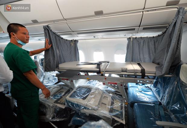Ảnh: Bên trong chuyến bay đặc biệt đón 120 công dân nhiễm Covid-19 tại Guinea Xích đạo về nước - Ảnh 10.