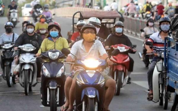 Bộ GTVT bỏ quy định bật đèn nhận diện xe máy ban ngày - Ảnh 1.