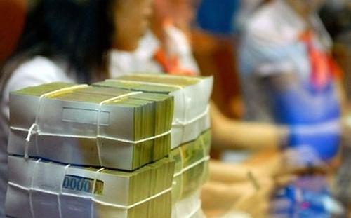 Các ngân hàng lớn tiếp tục giảm lãi suất gửi tiết kiệm  - Ảnh 1.