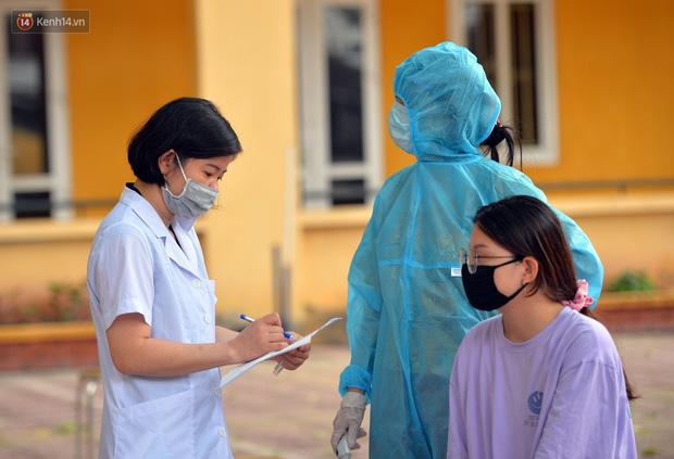 Ảnh: Hà Nội bắt đầu xét nghiệm PCR đối với người trở về từ Đà Nẵng - Ảnh 3.