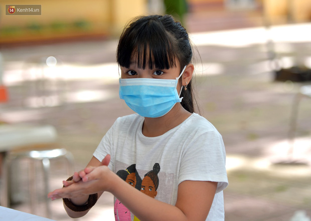 Ảnh: Hà Nội bắt đầu xét nghiệm PCR đối với người trở về từ Đà Nẵng - Ảnh 8.