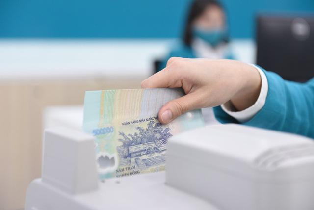 Yêu cầu ngân hàng cắt giảm lương, thưởng... để hạ lãi vay thực chất  - Ảnh 1.