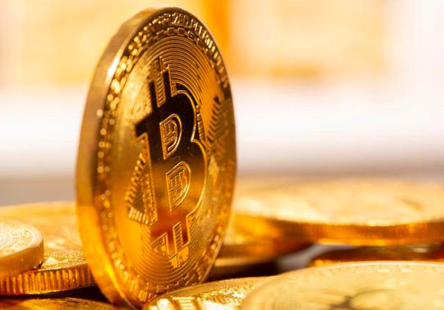 """Giá Bitcoin """"xuyên thủng"""" ngưỡng 58.000 USD/đồng - Ảnh 1."""