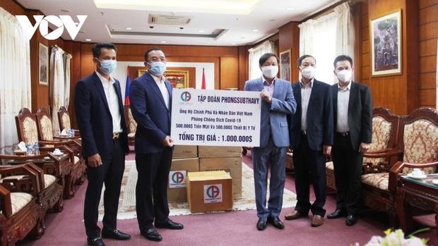 Doanh nghiệp Lào ủng hộ 1 triệu USD giúp Việt Nam chống dịch - Ảnh 1.