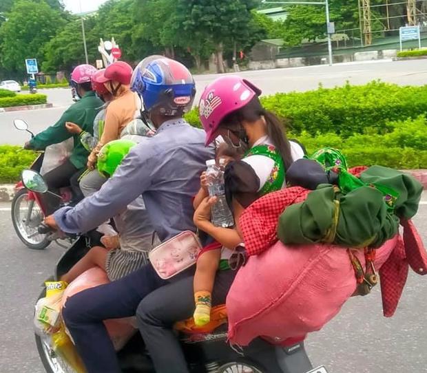 Hành trình 1400 km chạy xe máy từ miền Nam về quê của những người lao động nghèo tha hương - Ảnh 4.