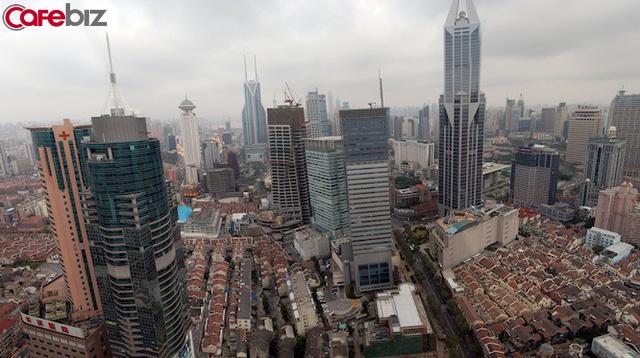 Giá nhà giảm 20/70 thành phố, bất động sản Trung Quốc đứng trước rủi ro bong bóng? - Ảnh 1.