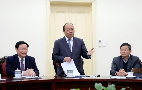 Thủ tướng làm việc với Tổ tư vấn kinh tế - Ảnh: Quang Hiếu