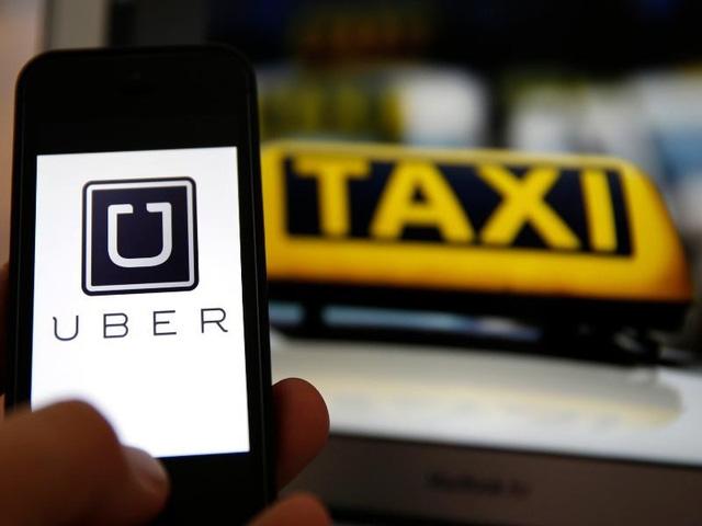 Hiệp hội Taxi Hà Nội kiến nghị dừng Uber, Grab - Ảnh 1.
