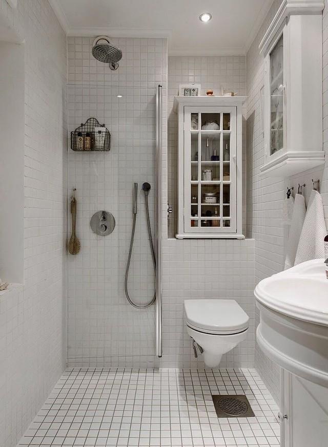 Căn hộ chỉ 50m2 được thiết kế tông màu trắng, đem lại không gian sống rộng rãi và sang trọng - Ảnh 13.