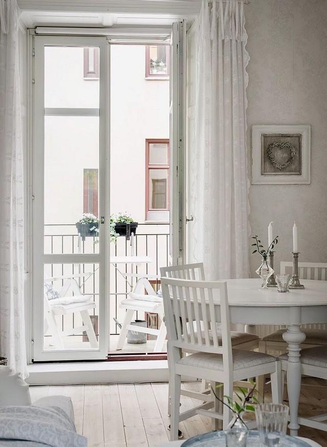 Căn hộ chỉ 50m2 được thiết kế tông màu trắng, đem lại không gian sống rộng rãi và sang trọng - Ảnh 6.