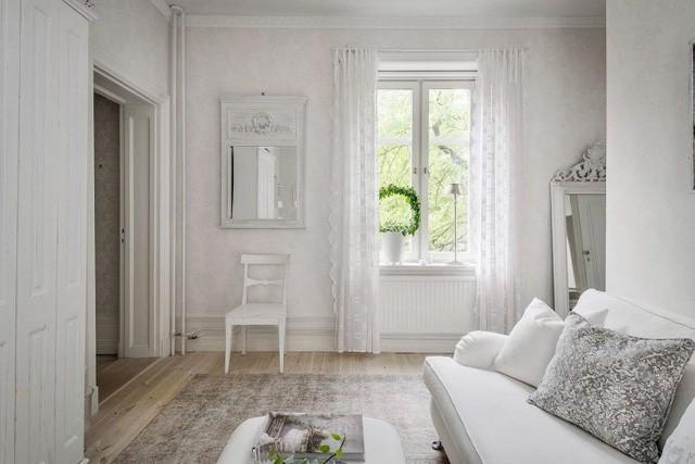 Căn hộ chỉ 50m2 được thiết kế tông màu trắng, đem lại không gian sống rộng rãi và sang trọng - Ảnh 8.