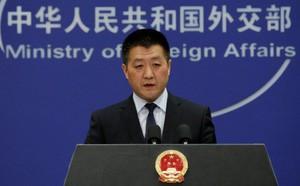 Bloomberg: Mỹ cùm được Huawei, nhưng Trung Quốc đã xích được con cưng của Mỹ từ trước - Ảnh 1.