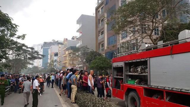 Hiện trường tan hoang vụ cháy chợ Quang ở Hà Nội - Ảnh 4.