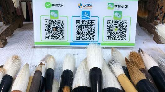 Trung Quốc: Ăn xin cũng dùng QR Code - Ảnh 3.