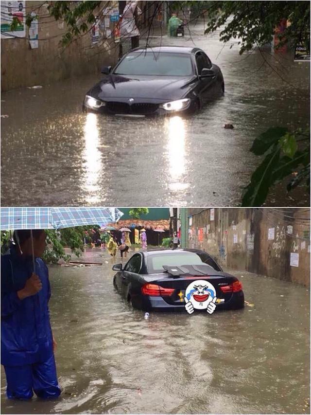 Hà Nội mưa lớn, xế sang cũng bơi giữa những con phố nay đã biến thành sông  - Ảnh 1.