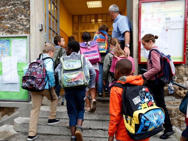 Ngày đầu tiên đi học của trẻ em trên khắp thế giới diễn ra như thế nào? - Ảnh 2.