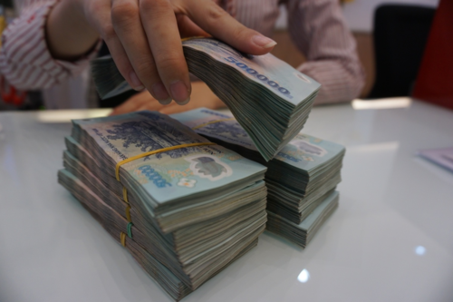 Choáng có mức thưởng Tết khủng của nhân viên ngân hàng, có người được thưởng đến 9 tháng thu nhập - Ảnh 1.