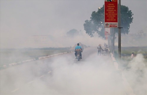Khói đốt rơm rạ đang bủa vây ngoại thành Hà Nội - Ảnh 9.