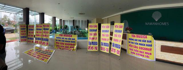 Băng rôn treo kín dự án Cocobay, khách hàng gửi đơn kiện lên Tòa án nhân dân Hà Nội: Thành Đô tuyên bố đơn phương hủy hợp đồng nếu hạn chót 30/12 khách hàng không chịu kí phương án  - Ảnh 1.