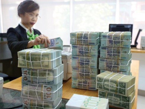 Ngân hàng ồ ạt tăng lãi suất tiền gửi sau Tết Nguyên đán  - Ảnh 1.