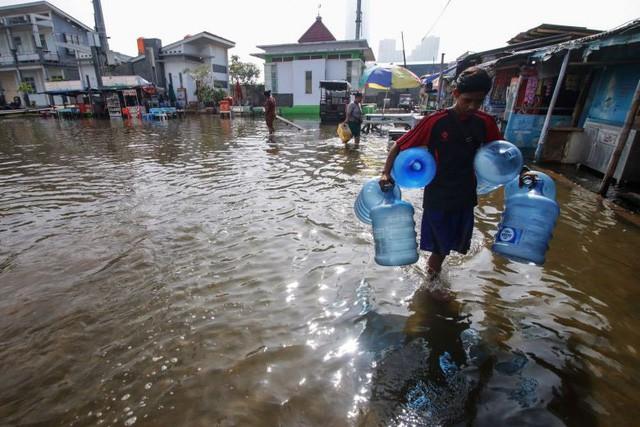 Jakarta chìm nhanh nhất thế giới, TP HCM đứng thứ 3, biến đổi khí hậu đáng sợ hơn rất nhiều so với chúng ta tưởng tượng - Ảnh 2.