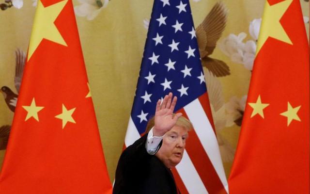 Tổng thống Trump dọa duy trì thuế nhập khẩu với hàng hóa Trung Quốc - Ảnh 1.