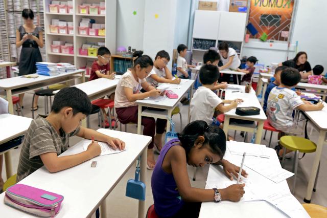 Mặt tối của nền giáo dục Singapore: Cả tỷ USD được chi mỗi năm vì nỗi ám ảnh Kiasu, trẻ em 12 tuổi thi chuyển cấp khắc nghiệt chẳng kém đại học - Ảnh 1.