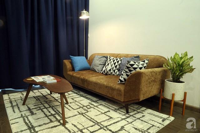 Căn hộ 90m² đẹp hiện đại với điểm nhấn màu xanh rất nam tính, có chi phí thi công 280 triệu đồng ở Hà Nội - Ảnh 4.