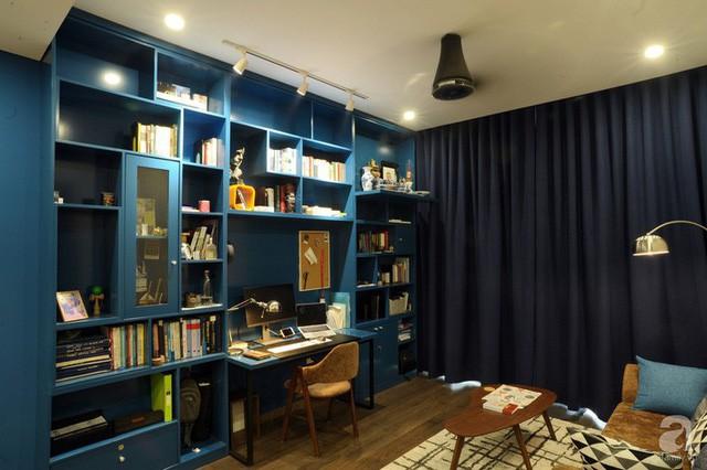 Căn hộ 90m² đẹp hiện đại với điểm nhấn màu xanh rất nam tính, có chi phí thi công 280 triệu đồng ở Hà Nội - Ảnh 6.