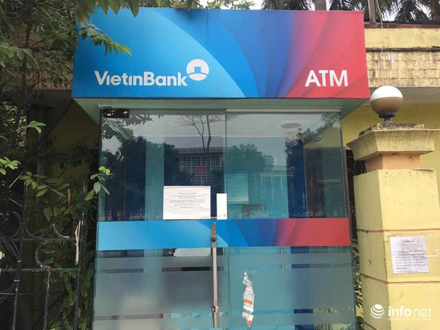 Tái diễn tình trạng ATM tê liệt, ngừng hoạt động... trong ngày cận Tết - Ảnh 2.