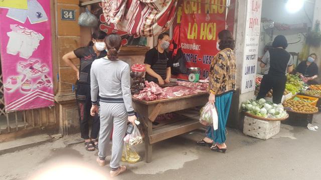 Sau chỉ đạo giảm giá, thịt lợn tại chợ truyền thống và siêu thị vẫn cao  - Ảnh 2.