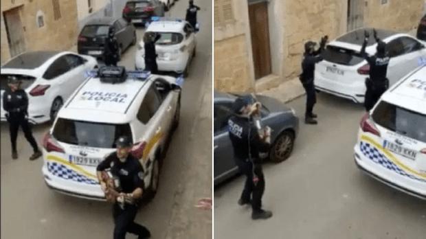 Khoảnh khắc hạnh phúc giữa lúc buồn chán: Anh cảnh sát chơi guitar hát cho cả phố nghe, xua đi bầu không khí u ám vì Covid-19 - Ảnh 2.