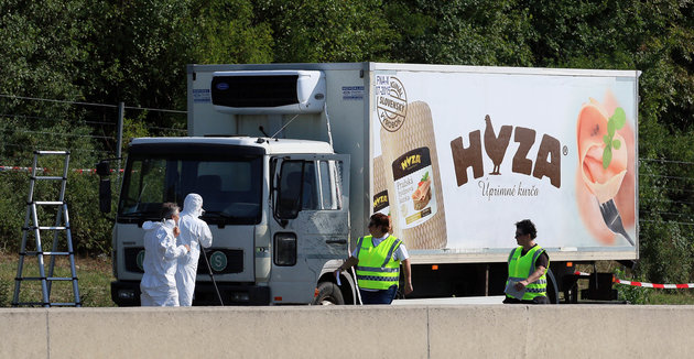 <span class=image-component__caption itemprop=caption>Police on the highway south of Vienna, Austria, near the truck where at least 20 migrants were found dead on Aug. 27, 2015.</span>